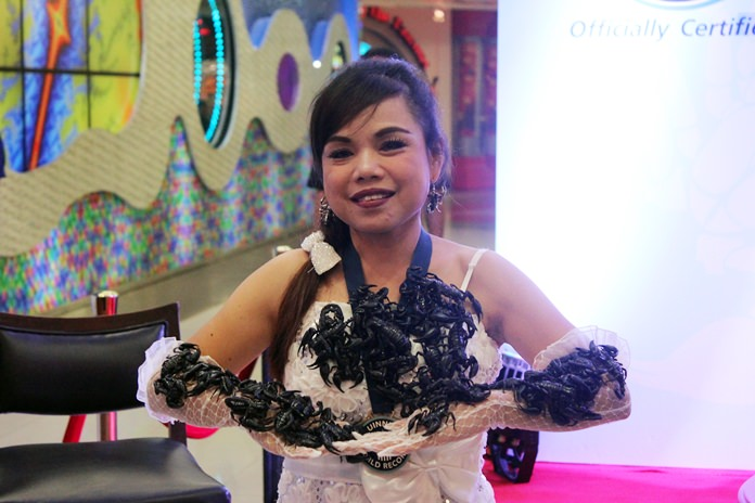 Kanchana Ketkaew, who set a Guinness World Record by living with 5,000 black scorpions for 33 days in 2009, will immerse herself in 100 scorpions several times a day Thursday through Tuesday at Royal Garden Plaza.