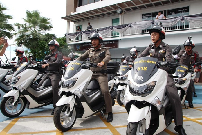 Pol. Col. Apichai Kroppech (center) takes possession of 37 new motorcycles for police use.