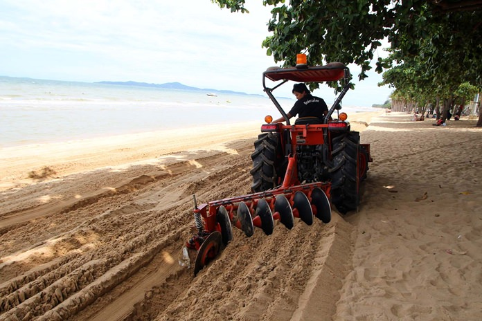 With the sand cleared of beach chairs and umbrellas, city work crews set about tilling the sand and removing rocks, garbage and other unwanted debris.