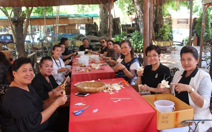 The Pattaya Women's Development Club has joined the effort to create artificial flowers for the cremation of HM the late King.