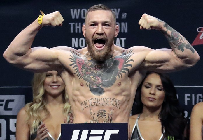 Ireland's Conor McGregor (pictured) will fight Floyd Mayweather Jr. in a boxing match on Aug. 26. (AP Photo/Julio Cortez)