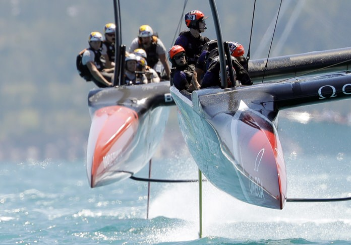 Emirates Team New Zealand, right, leads Oracle Team USA, left, during the fourth race of America's Cup competition, Sunday, June 18, in Hamilton, Bermuda. (AP Photo/Gregory Bull)