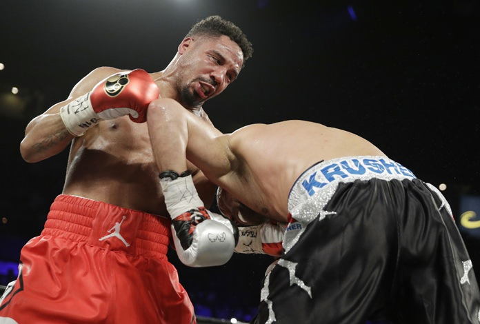 Andre Ward, left, hits Sergey Kovalev during their light heavyweight championship boxing match Saturday, June 17, in Las Vegas. (AP Photo/John Locher)