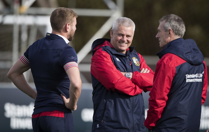 British and Irish Lions head coach Warren Gatland, center, talks with Finn Russell, left, and assistant coach Rob Howley during the team's captains run at Waikato Stadium in Hamilton, New Zealand, Monday, June 19. The Lions play the Chiefs here on Tuesday. (Brett Phibbs/New Zealand Herald via AP)