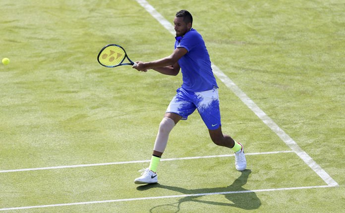 Australia's Nick Kyrgios is shown in action in his match against USA's Donald Young, during day one of the Queen's Club Championships in London, England, Monday June 19. (Steven Paston/PA via AP)