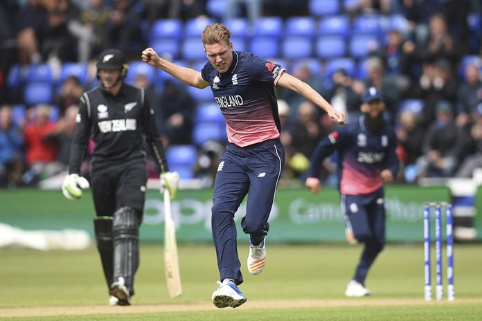 England's Jake Ball celebrates taking the wicket of New Zealand's Luke Ronchi during the ICC Champions Trophy Group A cricket match against New Zealand in Cardiff, Wales Tuesday June 6. (Joe Giddens/PA via AP)