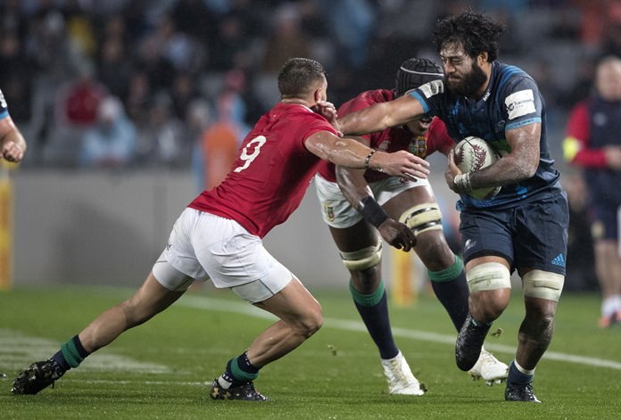 Auckland Blues Akira Ioane, right, fends off British & Irish Lions Rhys Webb during their match at Eden Park in Auckland, New Zealand, Wednesday, June 7. (Brett Phibbs/New Zealand Herald via AP)