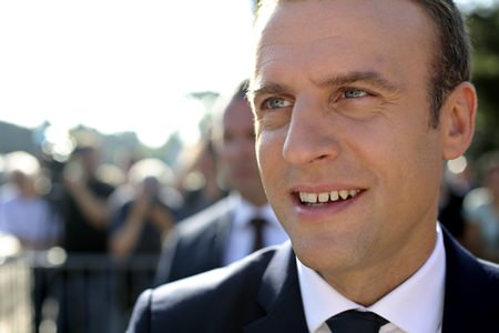 French President Emmanuel Macron meets people after voting in the final round of parliamentary elections, in the northern seaside town of Le Touquet, France, Sunday, June 18. (AP Photo/Thibault Camus)