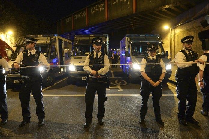 Police officers man a cordon at Finsbury Park where a vehicle struck pedestrians in London Monday, June 19. (Victoria Jones/PA via AP)