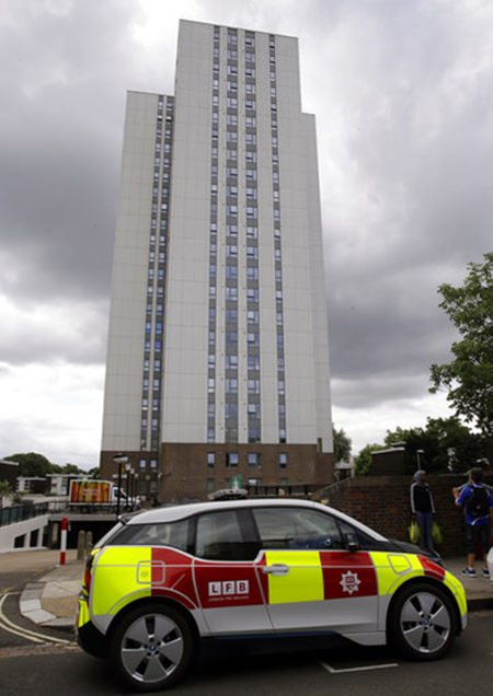 A fire patrol vehicle is parked outside Burnham block, part of the Chalcots Estate in the borough of Camden, north London, Saturday June 24, 2017. (AP Photo/Alastair Grant)