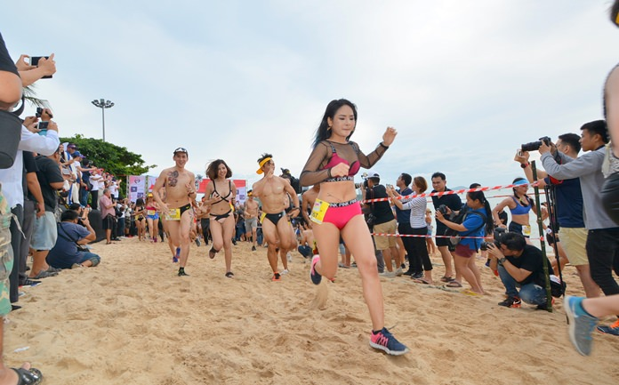 They're off! Clothes weren't about to slow down hundreds of people who participated in the 2017 Bikini Run Saturday, July 1. Races for the second-annual event began on the beach in front of Central Festival Pattaya Beach with the course running to the Dusit Thani Hotel and back.