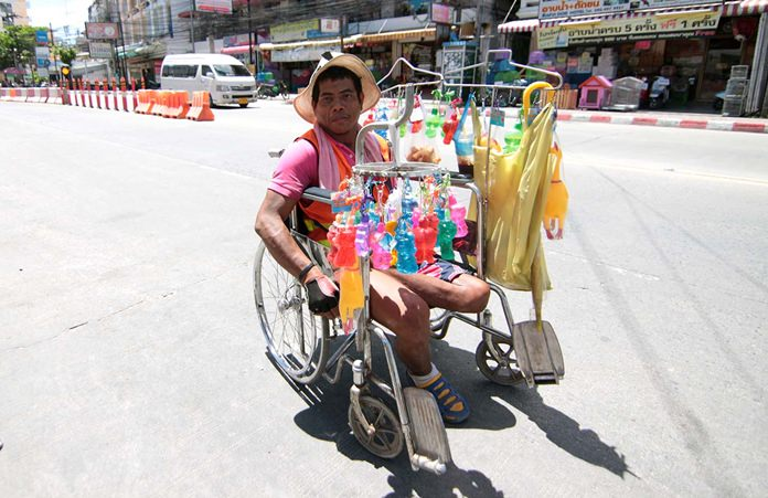 Every day Wiwat Waanproh can be seen in his wheelchair selling key chains to earn extra income for his family.