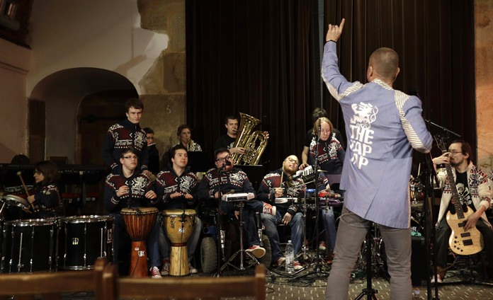 In this picture taken Feb. 23, 2017, members of the Tap Tap orchestra perform during a charity concert in Prague Czech Republic. (AP Photo/Petr David Josek)