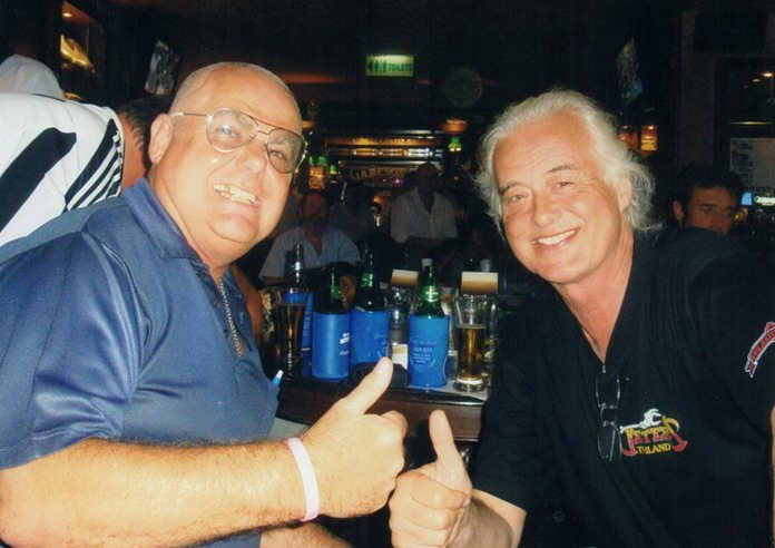 Mott the Dog (left) breaks bread with Led Zeppelin guitar legend Jimmy Page at Jameson's Irish Pub in Pattaya.