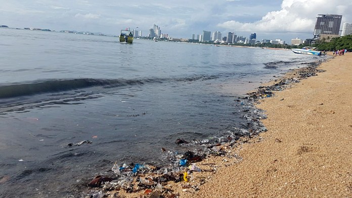 Citizens, residents and tourists alike took to social media to post images of black sand and inky, smelly water on Pattaya Beach near the old pier site near Walking Street. It's not the first time this has happened. A storm drainage pipe near the site has seen multiple repairs to traps and doors that prevent sewage outflows. It's possible it is broken again. Cleanup began July 15 and officials predicted it would take about a week to clean the beach of raw sewage that backed up and flowed into the sand and sea following a recent heavy storm.