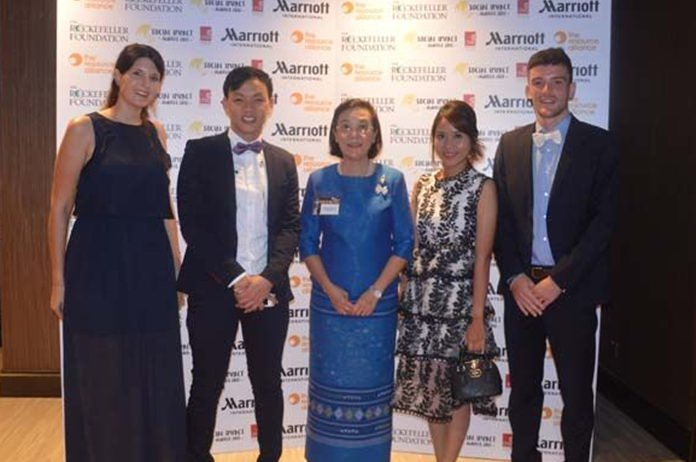 The HHNFT Team at the Gala Dinner: (from left) volunteer Hannah Heichen, Drop-In Manager Piroon Noi-Imjai, Director Radchada Chomjinda, Outreach Chief Thitiporn Saknarong, and volunteer Christian Frick.