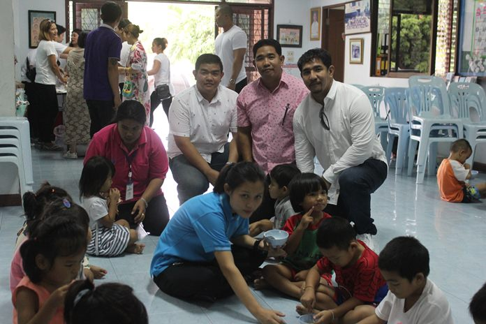 (Kneeling L to R) Chalermpol, Nakhon and Sakon Phonlookin celebrate their birthdays by throwing a party with the children of the Fountain of Life Center.