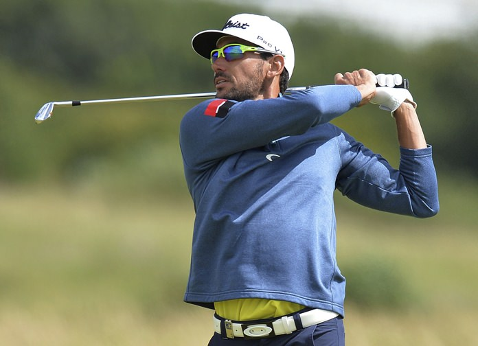 Spain's Rafa Cabrera Bello plays his second shot on the 1st hole during day four of the Scottish Open at Dundonald Links, Troon, Scotland, Sunday July 16. (Mark Runnacles/PA via AP)