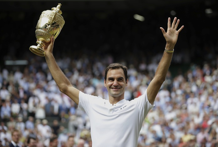 Switzerland's Roger Federer celebrates with the trophy after beating Croatia's Marin Cilic in the men's singles final match on day thirteen at the Wimbledon Tennis Championships in London Sunday, July 16. (Daniel Leal-Olivas/Pool Photo via AP)