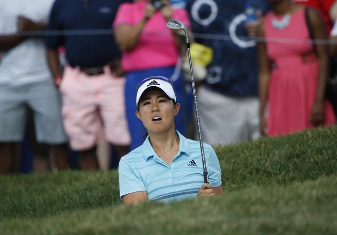 Danielle Kang plays out of a bunker on the 18th green during the third round of the Women's PGA Championship golf tournament at Olympia Fields Country Club Saturday, July 1. (AP Photo/Charles Rex Arbogast)