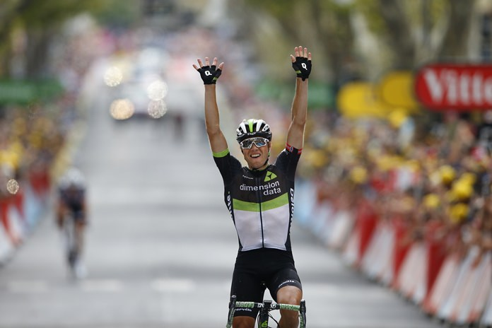 Norway's Edvald Boasson Hagen celebrates as he crosses the finish line to win the nineteenth stage of the Tour de France cycling race in Salon-de-Provence, France, Friday, July 21. (AP Photo/Peter Dejong)