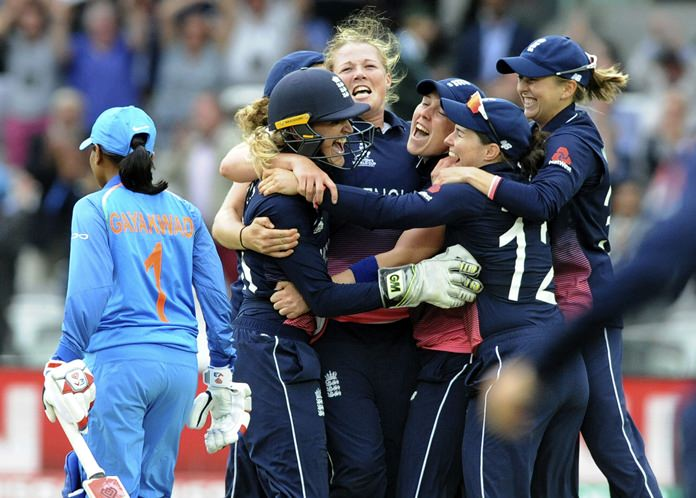 England's Anya Shrubsole, centre, celebrates with teammates as England win the ICC Women's World Cup 2017 final match against India at Lord's in London, England, Sunday, July 23. (AP Photo/Rui Vieira)