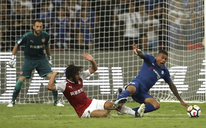 Chelsea's Kenedy, right, challenges for the ball with Arsenal's Mohamed El Neny during their teams' friendly soccer match in Beijing, China, Saturday, July 22. (AP Photo/Mark Schiefelbein)