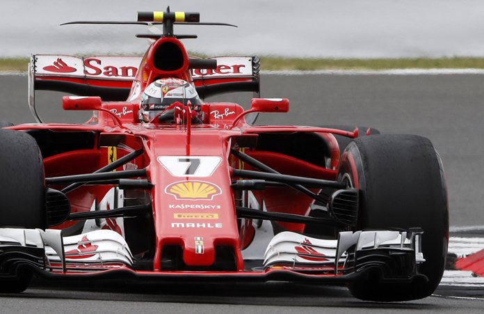Ferrari driver Kimi Raikkonen of Finland takes a curve during the British Formula One Grand Prix at the Silverstone racetrack in Silverstone, England, Sunday, July 16. (AP Photo/Frank Augstein)