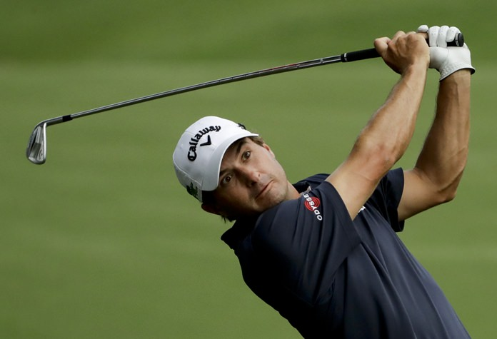 Kevin Kisner hits from the fairway on the 18th hole during the first round of the PGA Championship golf tournament at the Quail Hollow Club Thursday, Aug. 10, in Charlotte, N.C. (AP Photo/Chris O'Meara)