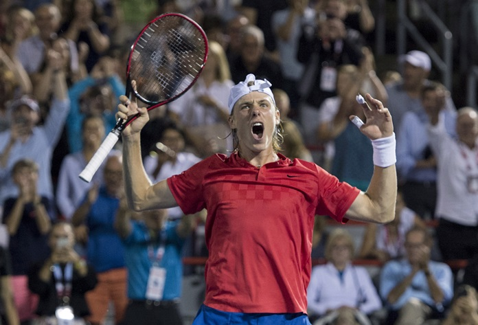 Denis Shapovalov, of Canada celebrates, after defeating Adrian Mannarino, of France, during the quarterfinals at the Rogers Cup tennis tournament Friday, Aug. 11, in Montreal. (Paul Chiasson/The Canadian Press via AP)