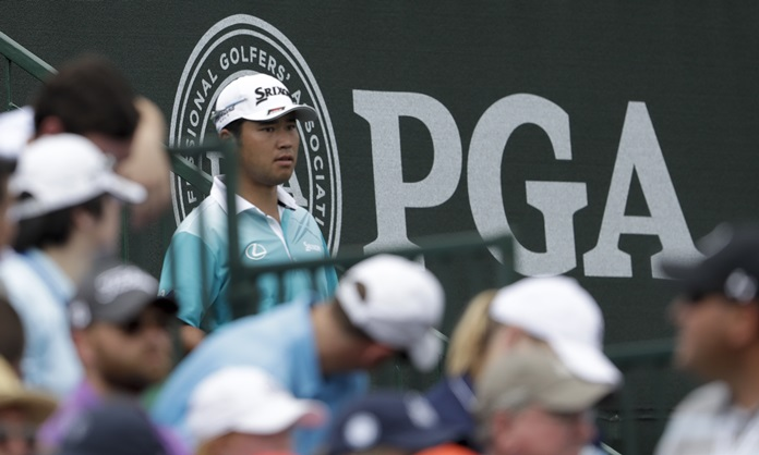 Hideki Matsuyama of Japan waits at the second tee during the second round of the PGA Championship golf tournament at the Quail Hollow Club Friday, Aug. 11, in Charlotte, N.C. (AP Photo/John Bazemore)
