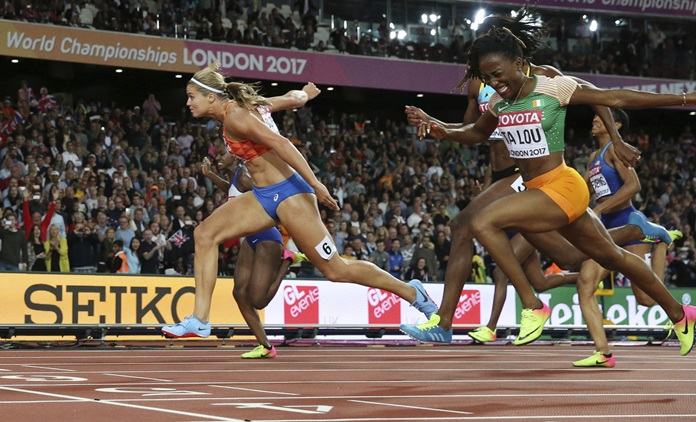 Dafne Schippers of the Netherlands, left, crosses the line to win the gold in the women's 200m final during the World Athletics Championships in London Friday, Aug. 11. Right is Ivory Coast's Marie-Josee Ta Lou who finished second. (AP Photo/Matthias Schrader)