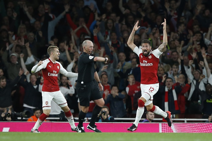 Arsenal's Olivier Giroud reacts and celebrates as referee Mike Dean, centre, says the ball has crossed the line for a goal during the English Premier League match against Leicester City at the Emirates stadium in London, Friday, Aug. 11. (AP Photo/Alastair Grant)