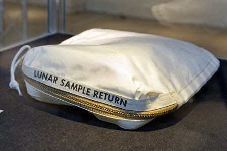 The Apollo 11 Contingency Lunar Sample Return Bag used by astronaut Neil Armstrong sold for $1.8 million at an auction on Thursday following a galactic court battle. The lunar dust plus some tiny rocks that Armstrong also collected are zipped up in a small bag. (AP Photo/Richard Drew)