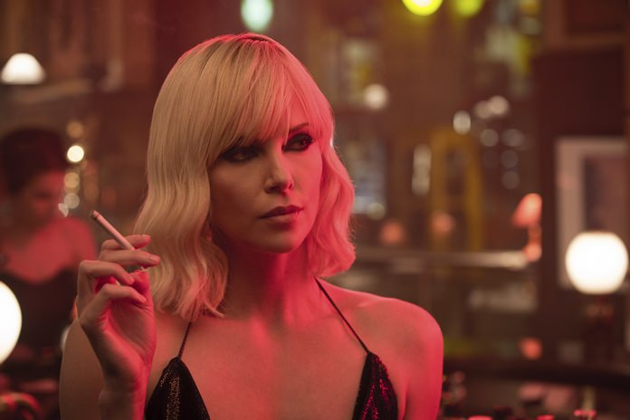 "This image shows Charlize Theron in a scene from ""Atomic Blonde."" (Jonathan Prime/Focus Features via AP)"