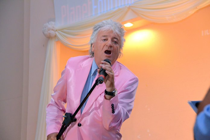 Morgan Kent as Rod Stewart belts out some classic hits.