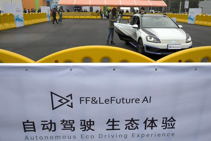 In this Oct. 21, 2016 photo, an autonomous vehicle is put through its paces at the World Robot Conference in Beijing. (AP Photo/Ng Han Guan)