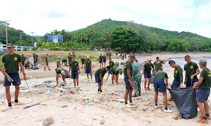 Sailors cleaned Had Tien Beach after a tidal wave of garbage washed ashore.