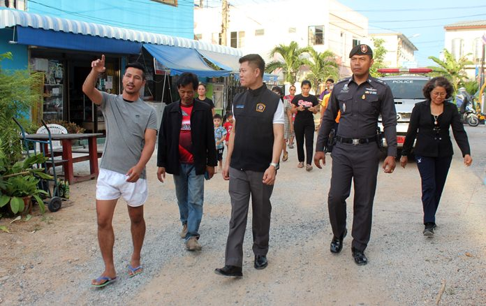 Community leader Virath Joyjinda leads police on a tour of the neighborhood where they were given an update on the Soi Korphai Community's award-winning anti-drug program in hopes of taking it to other troubled neighborhoods.