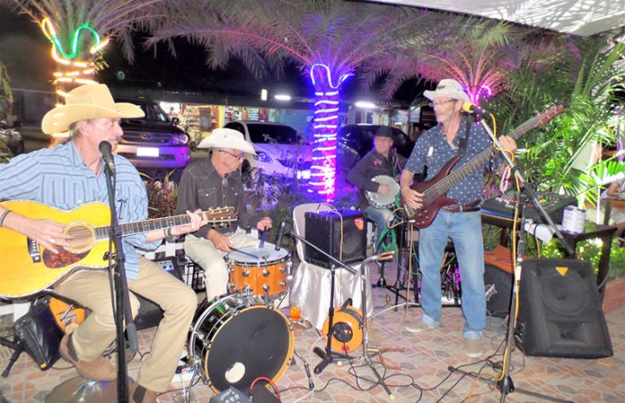 The live band played familiar country songs.