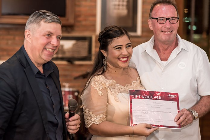 Roy Matthews from R&J asset management receives 1st prize; a 3 nights stay at the Amari in Phuket from Catherine Petit, Managing Director of FED Property Group.