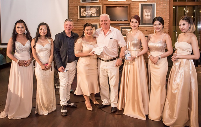 Catherine Petit hands over the 3rd lucky draw prize of a 5000b voucher for Silver Linings Restaurant to David Strachan of Pattaya Property Auctions.