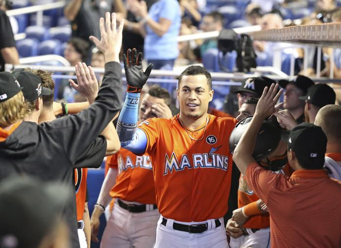 Giancarlo Stanton hits 42nd home run as Miami Marlins defeat Colorado Rockies