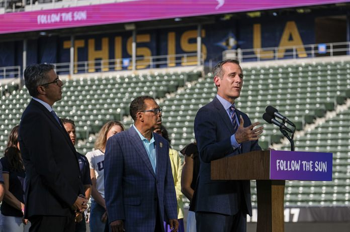 Los Angeles Olympic Committee leader Casey Wasserman, from left, and City Council President Herb look on as L.A. Mayor Eric Garcetti speaks during a press conference to make an announcement for the city to host the Olympic Games and Paralympic Games 2028, at Stubhub Center in Carson, outside of Los Angeles, Calif., Monday, July 31. (AP Photo/Ringo H.W. Chiu)