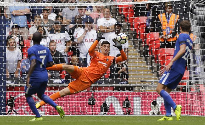 Chelsea goalkeeper Thibaut Courtois makes a save during the English Premier League match against Tottenham Hotspur at Wembley stadium in London, Sunday, Aug. 20. (AP Photo/Alastair Grant)
