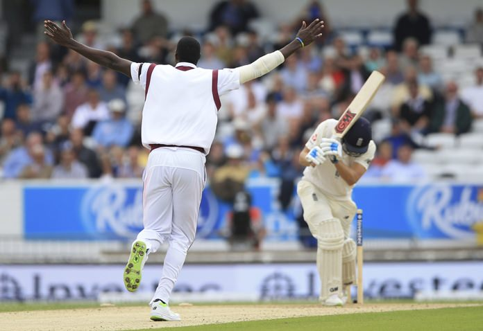 West Indies Jason Holder celebrates after taking the wicket of England's Dawid Malan during the second Test match at Headingley, Leeds, England, Friday Aug. 25. (Nigel French/PA via AP)