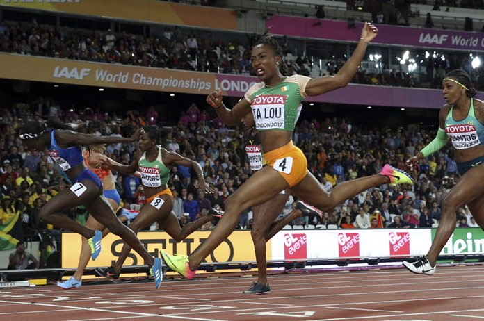 United States' Tori Bowie, left, crosses the line to win the gold in the women's 100-meter final during the World Athletics Championships in London Sunday, Aug. 6. (AP Photo/Matthias Schrader)