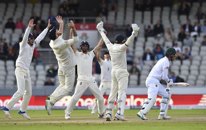 South Africa's Duanne Olivier, right, is caught by England's Ben Stokes, 2nd left, as England win the fourth and final test match of the series at Emirates Old Trafford in Manchester, England, Monday Aug. 7. (Anthony Devlin/PA via AP)