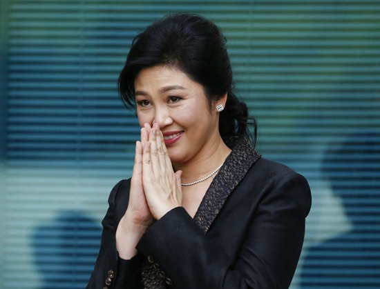 In this Aug. 1, 2017 file photo, Thailand's former Prime Minister Yingluck Shinawatra arrives at the Supreme Court for to make final statement of the hearing in Bangkok. (AP Photo/Sakchai Lalit, File)