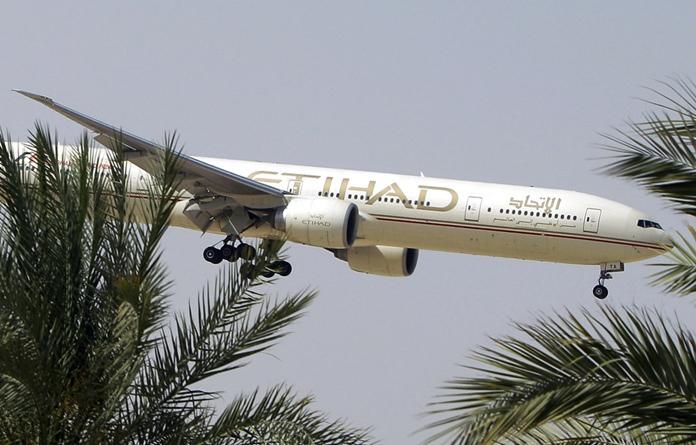 In this Sunday, May 4, 2014 file photo, an Etihad Airways plane prepares to land in Abu Dhabi Airport, United Arab Emirates. (AP Photo/Kamran Jebreili, File)